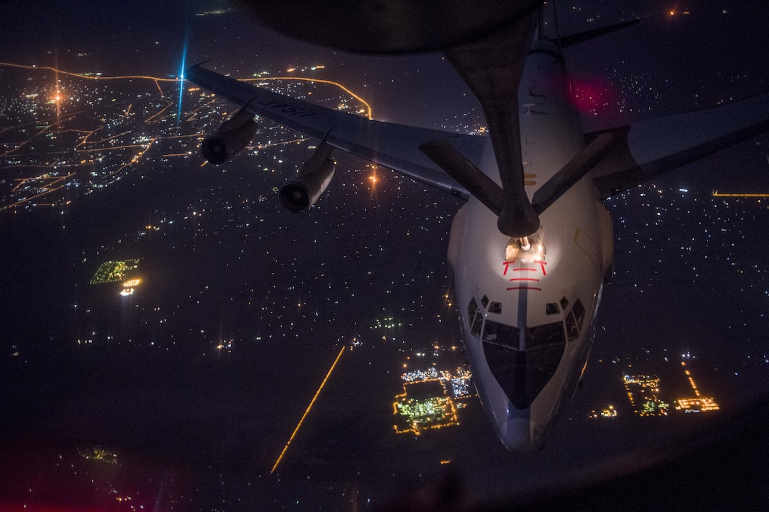 An Air Force E-3 Sentry aircraft meets a KC-135 Stratotanker during a refueling mission over Iraq while supporting Operation Inherent Resolve, Sept. 16, 2016. Air Force photo by Staff Sgt. Douglas Ellis