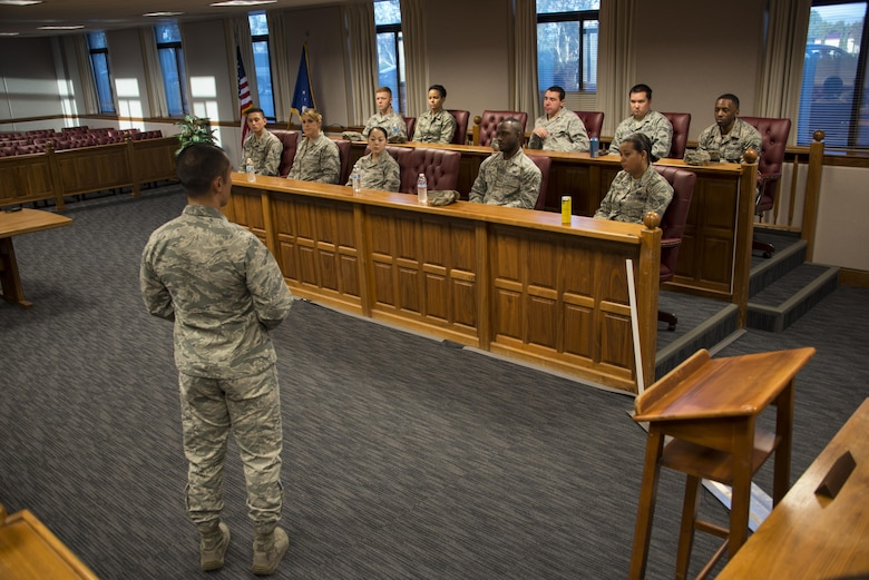 Capt. Joseph Cachuela, 60th Air Mobility Wing Legal Office attorney, front, discusses the different elements involved in a court-martial proceeding with Airmen participating in the True North program at Travis Air Force Base, Calif., Sept. 15, 2016. The True North program showcases the full spectrum of the military judicial process including incarceration. (U.S. Air Force photo by Staff Sgt. Charles Rivezzo)