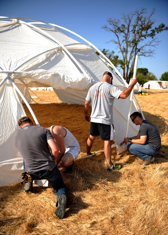 Airmen volunteering from Beale and Travis Air Force Bases, construct tents for the three-day Sacramento Stand Down event Sept. 13, 2016, at Rancho Cordova, California. The event is in its 25th year and provides shelter and multi-faceted assistance to homeless veterans in the Sacramento area. More than 70 Airmen volunteered their time. (U.S. Air Force photo/Staff Sgt. Jeffrey M. Schultze)