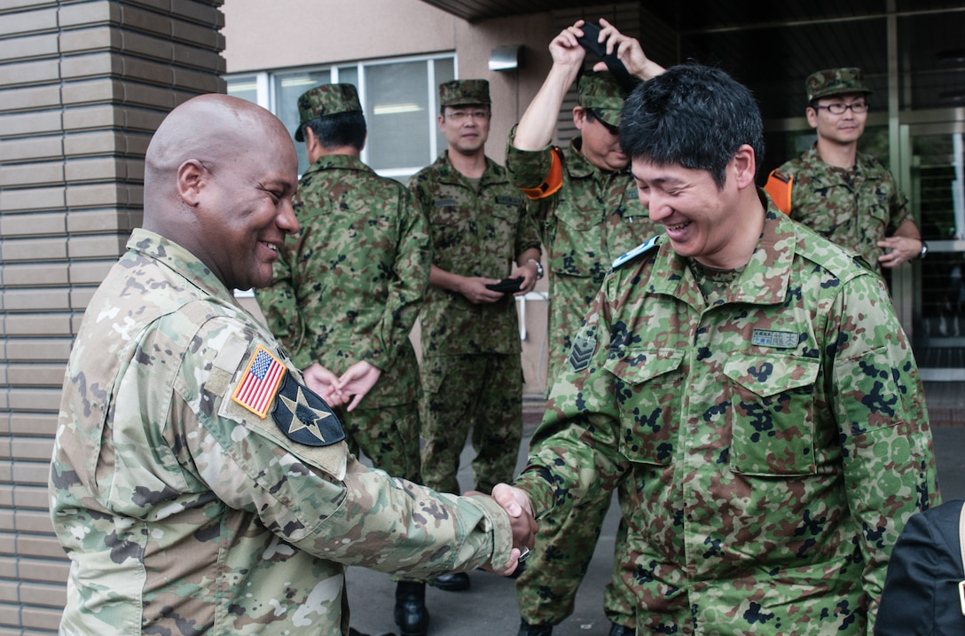 U.S. Army Sgt. Maj. Bennie Nunnally (left), senior enlisted advisor, Army Reserve Engagement Team-Japan, shakes hands with one of his Japan Ground Self-Defense Force partners at the conclusion of a Reserve Component bilateral engagement conducted Sept. 10, 2016, at Camp Sapporo, Japan. Nunnally visited Camp Sapporo to meet with senior Reserve Component leaders from the JGSDF Northern Army and observe how their noncommissioned officers conduct training in the field. (Photo by Sgt. John L. Carkeet IV, U.S. Army Japan)