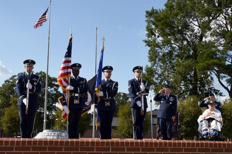 The Seymour Johnson Air Force Base Honor Guard presents the flags during the Prisoner of War/Missing in Action remembrance ceremony, Sept. 15, 2016 at Seymour Johnson Air Force Base, North Carolina. Retired Sgt. 1st Class Gaspar Gonzalez, Korean War POW and former U.S. Army Green Beret, spoke about his experience being held captive and honoring those who never made it home.  (U.S. Air Force photo by Airman Miranda A. Loera)