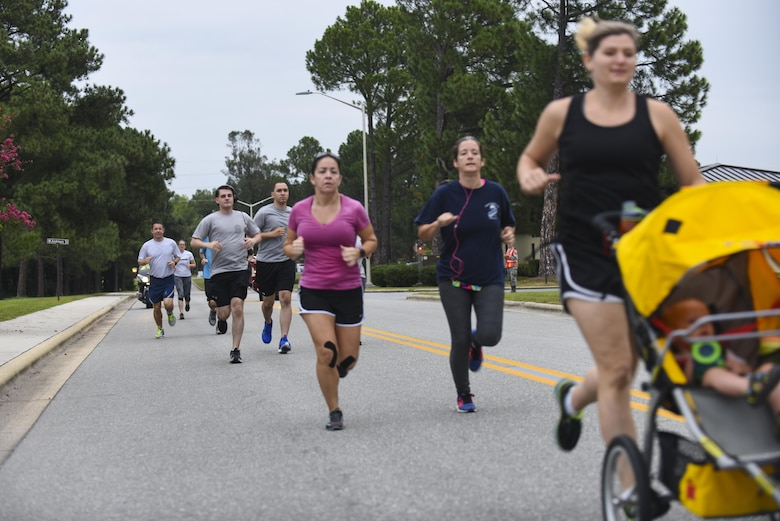 Team Seymour members finish a run to show support for military members who are Prisoners of War/Missing in Action, Sept. 12, 2016, at Seymour Johnson Air Force Base, North Carolina. Each year, Seymour Johnson AFB dedicates a week of events to recognize our nation's POW/MIAs to include ceremonies and runs. (U.S. Air Force photo by Airman 1st Class Ashley Williamson)