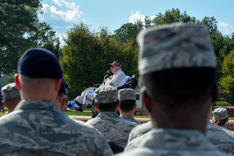 Members of Team Seymour listen as Gaspar Gonzalez, a former Korean War Prisoner of War and U.S. Army Green Beret, speaks during a Prisoners of War/Missing in Action Remembrance Ceremony, Sept. 15, 2016, at Seymour Johnson Air Force Base, North Carolina. Gonzalez spoke about his time as a POW and asked those in attendance to take care of those who'd come back and the families of those still missing. (U.S. Air Force photo by Airman Shawna L. Keyes)