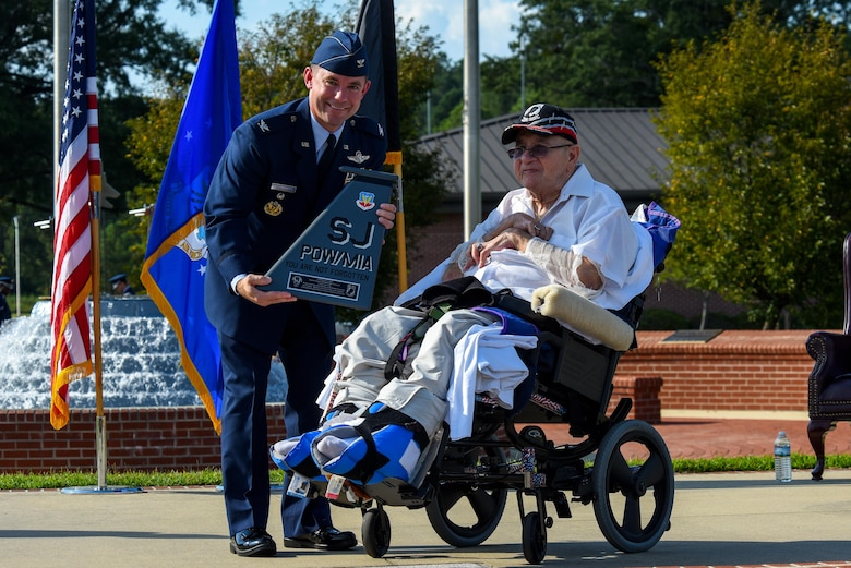 Col. Brian Armstrong (left), 4th Fighter Wing vice commander, presents Gaspar Gonzalez, a former Korean War Prisoner of War and U.S. Army Green Beret, with a tail flash, Sept. 15, 2016, at Seymour Johnson Air Force Base, North Carolina. Armstrong gave closing comments during the POW/MIA Remembrance ceremony and thanked Gonzalez for his service and his empowering story of survival and escape as a POW. (U.S. Air Force photo by Airman Shawna L. Keyes)
