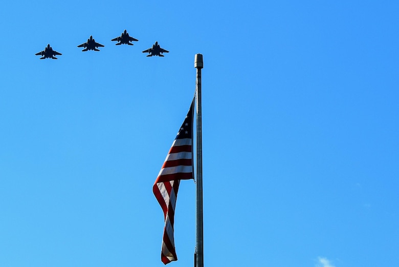 Four F-15E Strike Eagle aircraft from the 334th Fighter Squadron perform a missing man formation flyover during a Prisoners of War/Missing in Action Remembrance ceremony, Sept. 15, 2016, at Seymour Johnson Air Force Base, North Carolina. Gaspar Gonzalez, a former Korean War Prisoner of War and U.S. Army Green Beret, was the guest speaker during the ceremony and spoke about his 22 days in captivity by the Chinese during the Korean War. (U.S. Air Force photo by Airman Shawna L. Keyes)