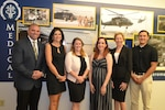 "The DLA Troop Support Medical supply chain's ""dream team"": from left to right, Alexander Quinones, integrated supply team chief; Denise Taubman, Amanda Doherty, and Danielle Delaney, contracting officers; Joanne Marie Grace, acquisition specialist; and Christopher Newman, intern."