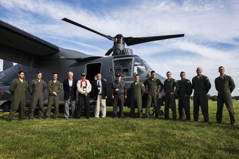 Current members of the 20th Special Operations Squadron at Cannon Air Force Base, N.M., stand with veterans of the 20th SOS in front of a CV-22 Osprey aircraft before the start of the Green Hornet Dedication ceremony at the National Museum of the United States Air Force near Wright-Patterson Air Force Base, Ohio, Sept. 15, 2016. The Osprey crew travelled from Cannon to honor the heritage of the 20th SOS with a landing, fly over and public display with the aircraft. (U.S. Air Force photo by Senior Airman Luke Kitterman/Released)