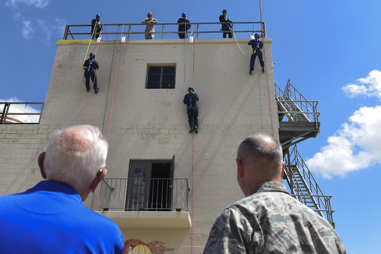 U.S. Air Force Col. Michael Downs, 17th Training Wing Commander, watches a rope rappelling demonstration at the Louis F. Garland Department of Defense Fire Academy on Goodfellow Air Force Base, Texas, Sept. 15, 2016. The demonstration was part of the Founders Week tour. (U.S. Air Force photo by Airman 1st Class Chase Sousa/Released)