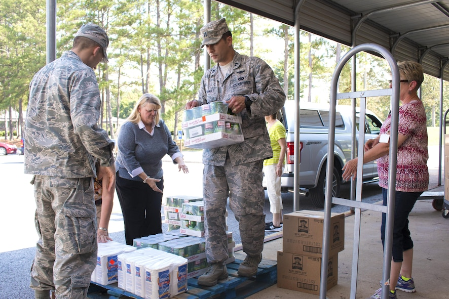 AEDC Feds Feed Families volunteers assist Good Samaritan personnel with loading 1,579 pounds of non-perishable food and dry good donations for delivery Aug. 31, 2016. Pictured left to right are AEDC volunteers Capt. Jonathan Diaz, Peggy Proffitt (behind Diaz), Pamela Anderson and Capt. Michael Davault; and Good Samaritan workers Fay Jones and Grace Thompson. (U.S. Air Force photo/Holly Peterson)
