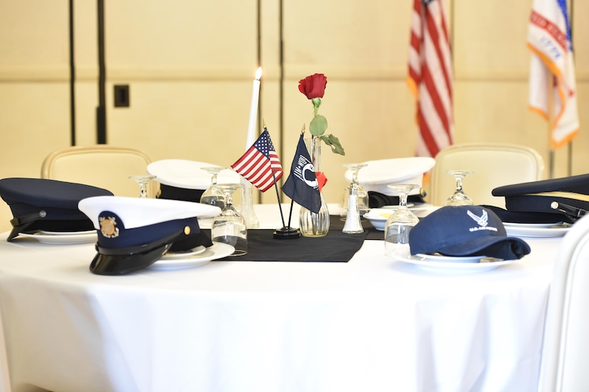 Service hats represent each branch of service on the POW/MIA table. Every year, members from Joint Base Charleston participate in a 24-hour vigil run, a luncheon to honor prisoners of war and those that are missing in action, as well as a formal retreat ceremony.