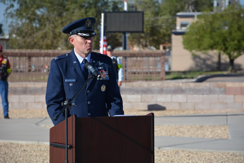 Colonel Ryan Craycraft, the 49th Wing vice commander, speaks at the POW/MIA remembrance ceremony at Holloman Air Force Base, N.M., on Sept. 16, 2016. The ceremony, which was in remembrance of prisoners of war and those still missing in action, were part of Holloman's POW/MIA commemoration. (U.S. Air Force photo by Staff Sgt. Warren Spearman)