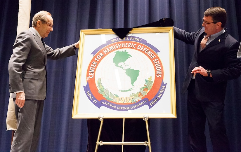 Former Defense Secretary William J. Perry, left, and then-Deputy Defense Secretary Ash Carter, unveil the William J. Perry Center for Hemispheric Defense Studies during a renaming ceremony April 2, 2013, at Fort Lesley J. McNair, Washington. Carter and Perry discussed defense innovation at the Hoover Institution, Sept. 19, 2016. Defense Department photo by Rachel Larue