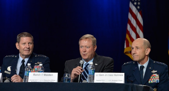 Randall G. Walden, the director and program executive officer of the Air Force Rapid Capabilities Office, answers a question during a B-21 panel at the Air Force Association's Air, Space and Cyber Conference in National Harbor, Md., Sept. 19, 2016. Gen. Robin Rand, the Air Force Global Strike Command commander,  and Lt. Gen. James Holmes, the deputy chief of staff, strategic plans and requirements, were also members of the panel. (U.S. Air Force photo/Staff Sgt. Whitney Stanfield)