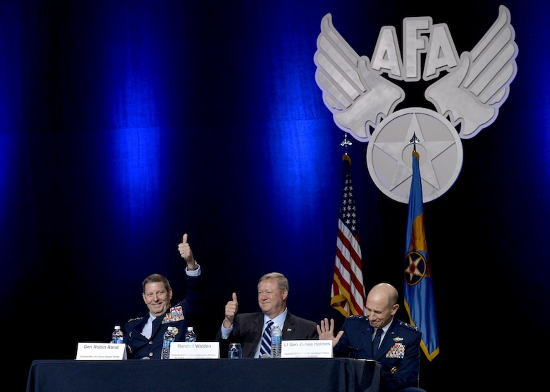 Gen. Robin Rand, the Air Force Global Strike Command commander, Randall G. Walden, the director and program executive officer of the Air Force Rapid Capabilities Office, and Lt. Gen. James Holmes, the deputy chief of staff, strategic plans and requirements, gives a thumbs-up to the B-21 bomber's new name during the Air Force Association's Air, Space and Cyber Conference in National Harbor, Md., Sept. 19, 2016. The B-21 will be known as the Raider. (U.S. Air Force photo/Staff Sgt. Whitney Stanfield)