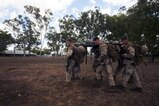 U.S. Marines with 1st Battalion, 1st Marine Regiment, Marine Rotational Force - Darwin, and Australian soldiers with 5th Battalion, Royal Australian Regiment, conduct a casualty evacuation drill during the Frontline Leaders Course at Robertson Barracks, Northern Territory, Australia, Sept. 10, 2016. The course is intended to be an addition to the Marine Corps Lance Corporal's Seminar, Corporal's Course, and Sergeant's Course. The course instills knowledge and leadership skills to positively impact those under their charge and the future of the Marine Corps. 1st Battalion, 1st Marine Regiment, created the course and this will be the first time the course has been officially conducted.