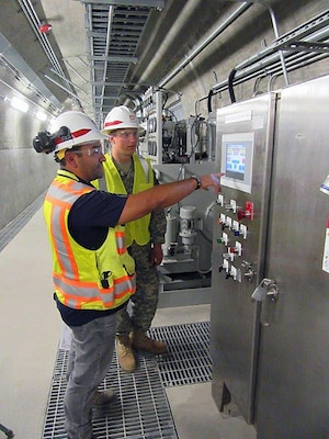 Cadet Sean Kasprisin, a third-year student in the University of Wyoming ROTC, learns about the Quality Assurance process at the Folsom Dam auxiliary spillway project from Daniel Figueroa, project engineer with the U.S. Army Corps of Engineers Sacramento District.