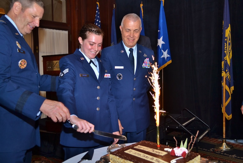 Gen. Robin Rand, Air Force Global Strike Command commander, Barksdale Air Force Base, Louisiana, assists as the youngest and oldest Airmen in attendance cut the cake during the Air Force birthday celebration hosted by and held at the Union League of Philadelphia, Sept. 16, 2016. This year the Air Force boasts 69 years as a military component. (U.S. Air Force photo by Tech. Sgt. Andria Allmond)