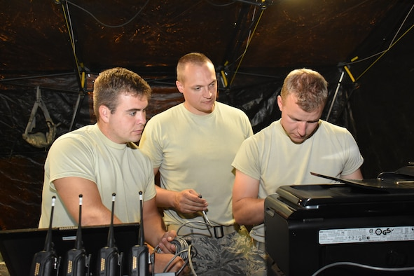 Airman 1st Class Michael Wedeward, left, Staff Sgt. Cory Sachtjen, center, and 1st Lt. Jeffrey Rutkowski, communications specialists for the Wisconsin Air National Guard's 115th Fighter Wing provide Joint Incident Site Communications Capability for the 2016 East Bay Stand Down Innovative Readiness Training exercise Sept. 16, 2016. The four day event allowed Guard and Reserve members from four service branches to meet critical training requirements while providing medical, dental and optometry care to the medically underserved, homeless veteran community of California's East Bay Region. (U.S. Air National Guard photo by Master Sgt. Paul Gorman/Released)