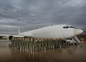Members of U.S. Strategic Command stand in front of their U.S. Navy E6-B Mercury at Minot Air Force Base, N.D., Sept. 19, 2016. The crew operates as the Airborne Command Post, having the ability to command and control U.S. STRATCOM's Intercontinental Ballistic Missiles. One of nine DoD unified combatant commands, USSTRATCOM has global strategic missions assigned through the Unified Command Plan that include strategic deterrence; space operations; cyberspace operations; joint electronic warfare; global strike; missile defense; intelligence, surveillance and reconnaissance; combating weapons of mass destruction; and analysis and targeting. (U.S. Air Force photo by Airman 1st Class J.T. Armstrong)