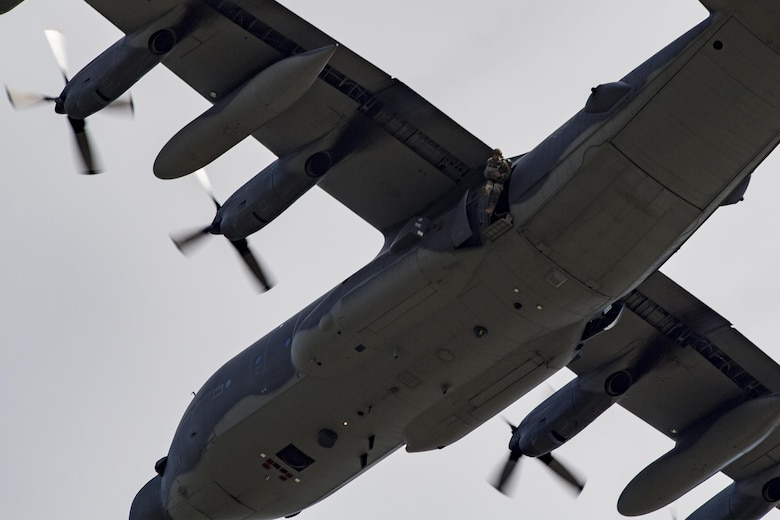 A U.S. Air Force Airman from the 823d Base Defense Squadron exits an MC-130H Combat Talon II during a static-line jump, Sept. 16, 2016, at the Lee Fulp drop zone in Tifton, Ga. Members of the 823d BDS jump often to maintain proficiencies. (U.S. Air Force photo by Airman Daniel Snider)