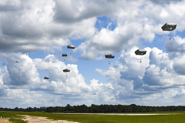 U.S. Air Force Airmen from the 823d Base Defense Squadron float during a static-line jump, Sept. 16, 2016, at the Lee Fulp drop zone in Tifton, Ga. During static-line jumps, Airmen attach their parachute's ripcord to the aircraft, so that when they exit, the parachute opens automatically. (U.S. Air Force photo by Airman 1st Class Daniel Snider)