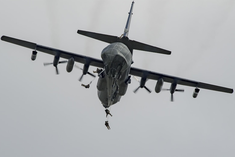 U.S. Air Force Airmen from the 823d Base Defense Squadron depart an MC-130H Combat Talon II during a static-line jump, Sept. 16, 2016, at the Lee Fulp drop zone in Tifton, Ga. The majority of the 823d is security forces members trained to deploy and protect. (U.S. Air Force photo by Airman 1st Class Daniel Snider)