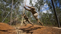 U.S. Marines with 1st Battalion, 1st Marine Regiment, Marine Rotational Force - Darwin, and Australian soldiers with 5th Battalion, Royal Australian Regiment, overcome various obstacles during the Frontline Leaders Course at Robertson Barracks, Northern Territory, Australia, Sept. 9, 2016. The course is intended to be an addition to the Marine Corps Lance Corporal's Seminar, Corporal's Course, and Sergeant's Course. The course instills knowledge and leadership skills to positively impact those under their charge and the future of the Marine Corps. 1st Battalion, 1st Marine Regiment, created the course and this will be the first time the course has been officially conducted.