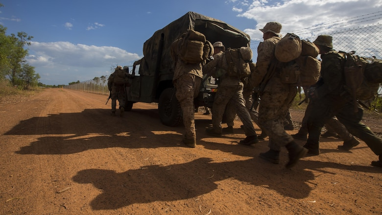 U.S. Marines with 1st Battalion, 1st Marine Regiment, Marine Rotational Force - Darwin, and Australian soldiers with 5th Battalion, Royal Australian Regiment, push a vehicle during the Frontline Leaders Course at Robertson Barracks, Northern Territory, Australia, Sept. 9, 2016. The course is intended to be an addition to the Marine Corps Lance Corporal's Seminar, Corporal's Course, and Sergeant's Course. The course instills knowledge and leadership skills to positively impact those under their charge and the future of the Marine Corps. 1st Battalion, 1st Marine Regiment, created the course and this will be the first time the course has been officially conducted.