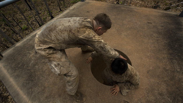 U.S. Marines with 1st Battalion, 1st Marine Regiment, help one another complete an obstacle during the Frontline Leaders Course at Robertson Barracks, Northern Territory, Australia, Sept. 9, 2016. The course is intended to be an addition to the Marine Corps Lance Corporal's Seminar, Corporal's Course, and Sergeant's Course. The course instills knowledge and leadership skills to positively impact those under their charge and the future of the Marine Corps. 1st Battalion, 1st Marine Regiment, created the course and this will be the first time the course has been officially conducted.