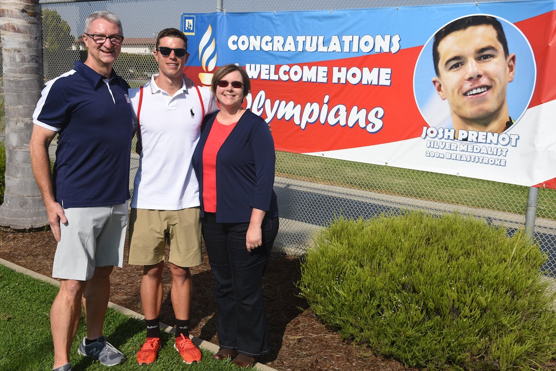 Bill Prenot, 30th Space Wing director of plans and programs, Josh Prenot, University of California Berkeley Physics major and swimmer, and Tammy Prenot, Josh's mother, pose for a photo at the Santa Maria Swim Club, Sept. 9, 2016, Santa Maria, Calif. Josh recently returned home to Santa Maria for the first time since his silver medal performance in the 2016 Rio de Janeiro Olympic Games. (U.S. Air Force photo by Airman 1st Class Robert J. Volio/Released)