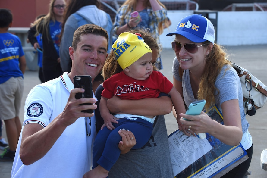 Josh Prenot, University of California Berkeley Physics major and swimmer, takes a photo with fans at the Santa Maria Swim Club, Sept. 9, 2016, Santa Maria, Calif. Josh recently returned home to Santa Maria for the first time since his silver medal performance in the 2016 Rio de Janeiro Olympic Games. (U.S. Air Force photo by Airman 1st Class Robert J. Volio/Released)