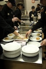 Kitchen staff members prepare plates with food during the Air Force Ball at Club Eifel on Spangdahlem Air Base, Germany, Sept. 17, 2016. More than 300 members attended the annual event commemorating the Air Force's birthday. The celebration included the Singing Sabers, a guest speaker, a three course formal dinner and dancing. (U.S. Air Force photo by Airman 1st Class Preston Cherry/Released)