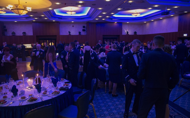 Airmen attend the Air Force Ball at Club Eifel on Spagdahlem Air Base, Germany, Sept. 17, 2016. The event celebrated the 69th anniversary of the U.S. Air Force, which formed as a separate branch of the U.S. military Sept. 18, 1947. (U.S. Air Force photo by Airman 1st Class Preston Cherry/Released)