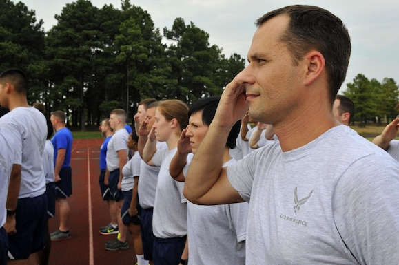 The 19th Operations Support Squadron salute during the National Anthem to kick off the Prisoner of War/Missing in Action remembrance run Sept. 15, 2016, at Little Rock Air Force Base, Ark. More than 83,000 Americans remain missing from the World War II, Korean War, Cold War, Vietnam War andthe 1991 Gulf War. (U.S. Air Force photo by Airman Kevin Sommer-Giron)