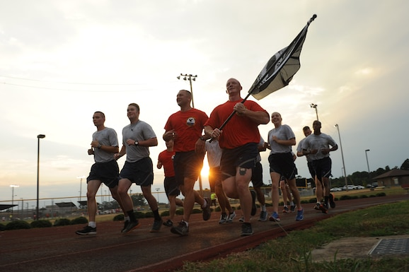 Members of the 19th Civil Engineer Squadron run in formation as part of the Prisoner of War/Missing in Action run Sept. 15, 2016, at Little Rock Air Force Base, Ark. The 24-hour run is an annual event including Airmen from more than 25 squadrons across base. (U.S. Air Force photo by Senior Airman Mercedes Taylor)