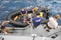 Sailors prepare for dive operations aboard a Mark VI patrol boat during Valiant Shield 2016 in Santa Rita, Guam, Sept. 14, 2016. Navy photo by Petty Officer 1st Class Arthurgwain L. Marquez