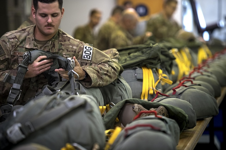 U.S. Air Force Senior Airman Nicholas McKeehan, 823d Base Defense Squadron, dons a parachute prior to participating in a static-line jump, Sept. 16, 2016, at Moody Air Force Base, Ga. Prior to each jump, a jumpmaster conducts an inspection to ensure each jumper's parachute is properly prepared. (U.S. Air Force photo by Staff Sgt. Ryan Callaghan)