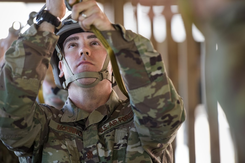 U.S. Air Force Maj. Brandon McKinnon, 823d Base Defense Squadron commander, attaches his static-line to an overhead cable during static-line practice jumps, Sept. 16, 2016, at Moody Air Force, Ga. Static-line jumps are typically conducted between 1,000 and 1,500 feet. (U.S. Air Force photo by Staff Sgt. Ryan Callaghan)