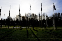 U.S. Air Force Airmen assigned to the 354th Fighter Wing prepare to lower state flags during the POW/MIA Recognition Day Retreat Ceremony, Sept. 16, 2016, at Heritage Park on Eielson Air Force Base, Alaska. The ceremony is held every year to honor the POW's and those MIA. (U.S. Air Force photo by Airman Isaac Johnson)