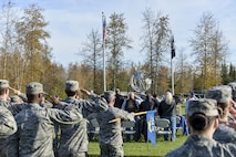 U.S. Air Force Airmen and civilians assigned to the 354th Fighter Wing salute the POW/MIA flag during the POW/MIA Recognition Day Retreat Ceremony, Sept. 16, 2016, at Heritage Park on Eielson Air Force Base, Alaska. POW/MIA Recognition day is typically recognized on the third Friday of September every year. (U.S. Air Force photo by Airman Isaac Johnson)