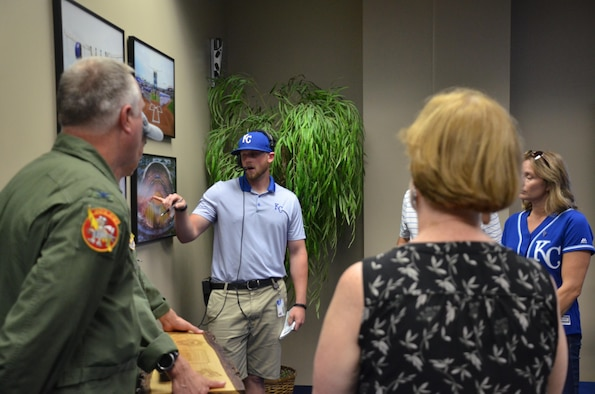 A Kauffman Stadium staff member briefs military representatives, including U.S. Air Force Col. Gregory Eckfeld, 442nd Fighter Wing vice commander, and Lt. Col. Lee Saugstad, 303rd Fighter Squadron pilot, before a Royals game in Kansas City, Mo., Sept. 19, 2016. Royals Charities, created in 2001, is the charitable foundation of the Kansas City Royals that provides military members and their families financial support. Local organizations were invited to the game so they could be presented a $350,000 check. (U.S. Air Force photo/Senior Airman Missy Sterling)