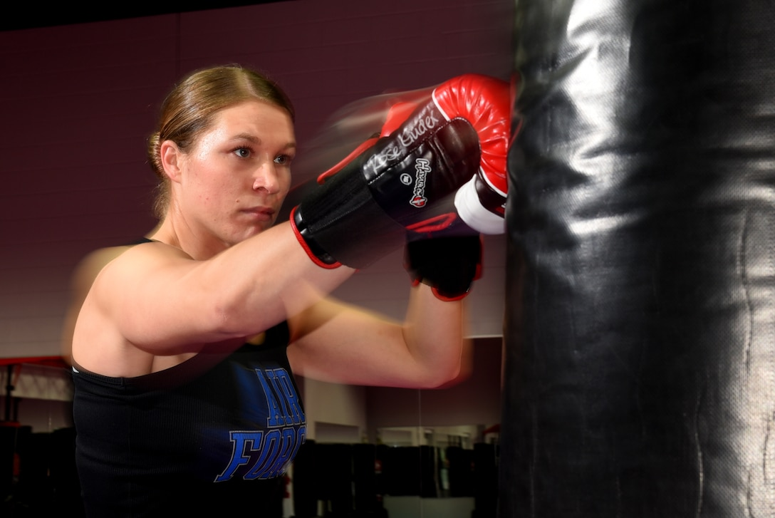 COLORADO SPRINGS, Colo. – Senior Airman Rose Gudex, 21st Space Wing Public Affairs photojournalist, relieves stress through kickboxing at a local gym in Colorado Springs, Colo., Sept. 14, 2016. After going through some difficult situations in her life, Gudex turned to fitness as a way to channel frustrations. (U.S. Air Force photo by Airman 1st Class Dennis Hoffman)