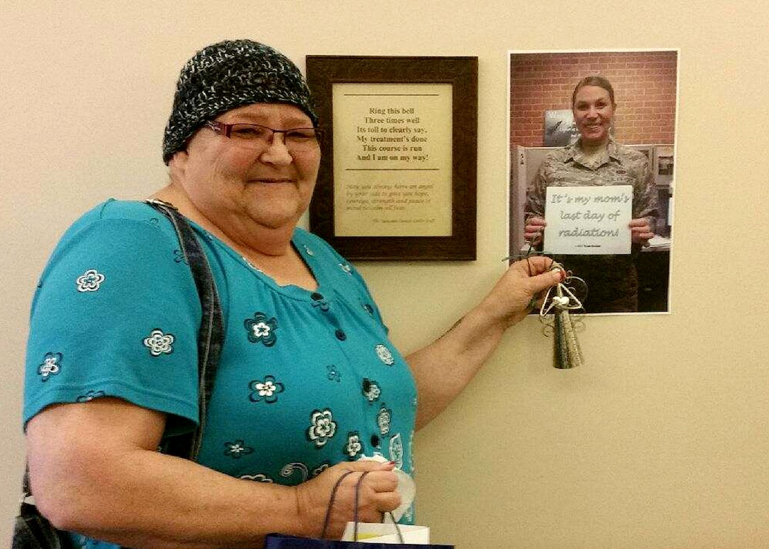 FOND DU LAC, Wis. – Senior Airman Rose Gudex, 21st Space Wing Public Affairs photojournalist, sent a photo to her mother's cancer treatment center to be displayed on the day she finished radiation in Fond du Lac, Wis., Sept. 18, 2015. Even though Gudex couldn't be there for physical support, she was there in spirit as her mom rang the bell to signify a major milestone. (Courtesy photo)