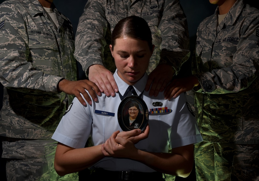 PETERSON AIR FORCE BASE, Colo. – Senior Airman Rose Gudex, 21st Space Wing Public Affairs photojournalist, surrounds herself with her Air Force family from Peterson Air Force Base, Colo., during difficult times. Gudex didn't have a solid support system before joining the military, but found a family in her brothers and sisters in arms. (U.S. Air Force photo by Airman 1st Class Dennis Hoffman)