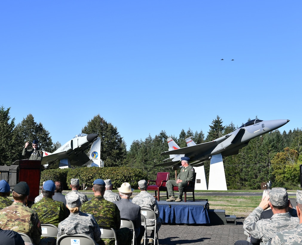 Two F-15s from the 142nd Fighter Wing, Oregon Air National Guard, fly over the Western Air Defense Sector during the F-15 static display dedication ceremony Sept. 13. The WADS has been guarding America's skies in the same building 24/7 since 1960 and regularly uses F-15 alert aircraft to perform its mission. (U.S. Air National Guard photo by Kimberly D. Burke)