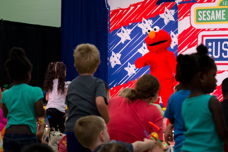 Children dance along with Sesame Street character, Elmo, during the Sesame Street/USO Experience for Military Families tour in the Fort Eustis Youth Center at Joint Base Langley-Eustis, Va., Sept. 16, 2016. The Sesame Street/USO Experience for Military Families tour made its debut in July 2008 and is the longest running entertainment tour in USO history. (U.S. Air Force photo by Staff Sgt. J.D. Strong II)