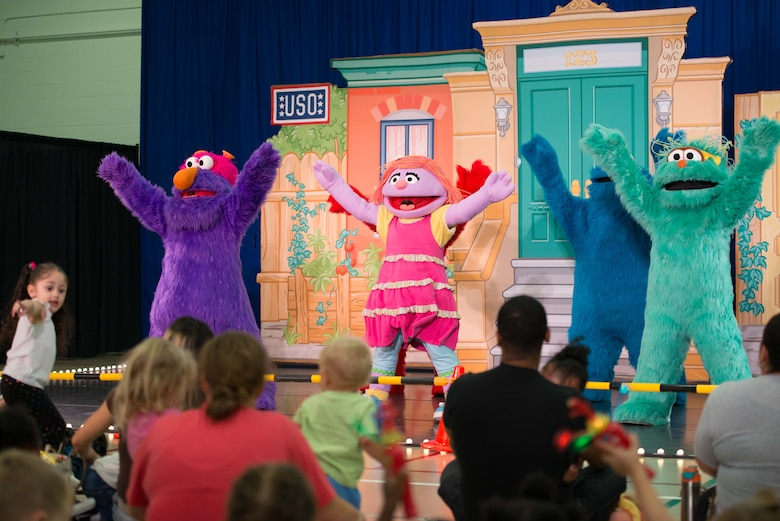 Sesame Street characters sing and dance during the Sesame Street/USO Experience for Military Families tour in the Fort Eustis Youth Center at Joint Base Langley-Eustis, Va., Sept. 16, 2016. This year marks the tour's sixth year visiting military installations in the U.S. and abroad. (U.S. Air Force photo by Staff Sgt. J.D. Strong II)