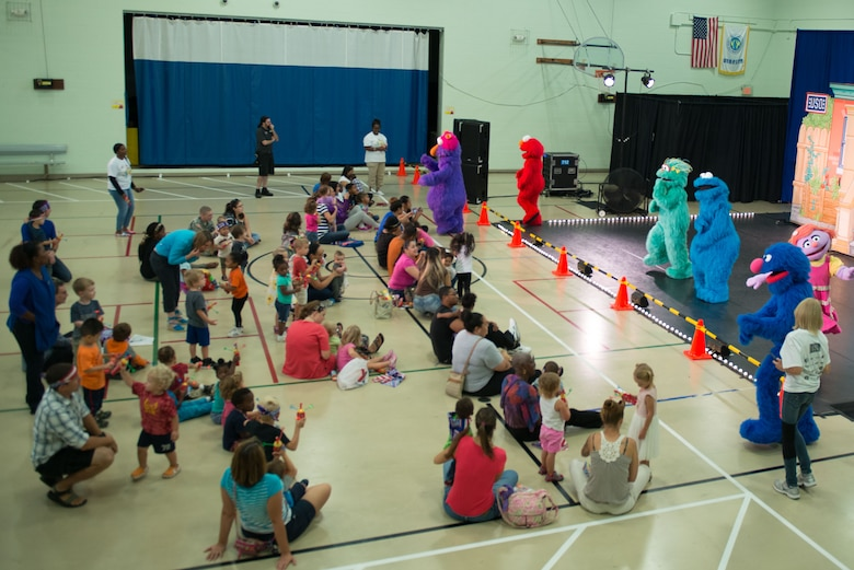 Sesame Street characters sing and interact with patrons during the Sesame Street/USO Experience for Military Families tour in the Fort Eustis Youth Center at Joint Base Langley-Eustis, Va., Sept. 16, 2016. Since its inception, the tour has taken its message to more than 540,000 troops and military families and performed more than 1,000 shows on 149 military installations in 33 states and 11 countries. (U.S. Air Force photo by Staff Sgt. J.D. Strong II)