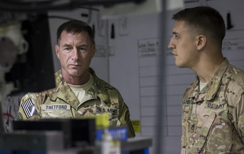 Command Sgt. Maj. William Thetford, left, the senior enlisted leader of U.S. Central Command, listens to Staff Sgt. Matthew Van De Car, right, explain his capabilities as an allied-trade noncommissioned officer with the 1106th Theater Aviation Sustainment Maintenance Group on Sep. 14, 2016 at Camp Arifjan, Kuwait. Thetford visited troops at Camp Arifjan as part of his two-day visit to the country. (U.S. Army photo by Sgt. Angela Lorden)