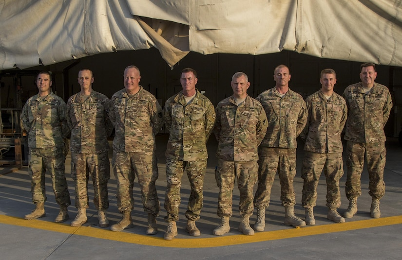Soldiers with the 1106th Theater Aviation Sustainment Maintenance Group pose for a group photo with Command Sgt. Maj. William Thetford, center, the senior enlisted leader of U.S. Central Command, on Sep. 14, 2016 at Camp Arifjan, Kuwait. The 1106th TASMG was one of the many units Thetford visited during his two-day tour in Kuwait to reinforce his understanding of U.S. Army Central's capabilities. (U.S. Army photo by Sgt. Angela Lorden)